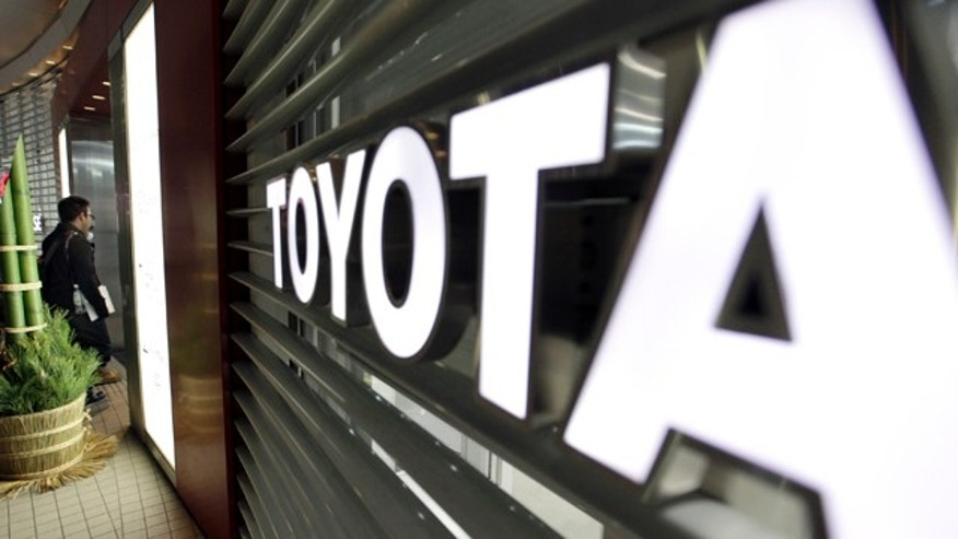 Dec. 27, 2012: A visitor enters a Toyota showroom in Tokyo.