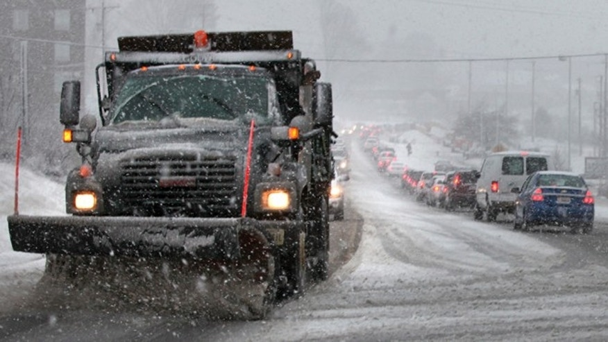 A snowplow scrapes route 144, Peppers Ferry Blvd near New River Valley Mall in Christiansburg, Via. Thursday Jan. 17, 2013.  A winter storm was making its way across the Southeast on Thursday, dumping 4 inches of snow in Mississippi and playing a role in a traffic fatality there, with the system expected to spread across northern Georgia and into the Washington, D.C., area, according to the National Weather Service. (AP Photo/The Roanoke Times, Matt Gentry)  LOCAL TV OUT; SALEM TIMES REGISTER OUT; FINCASTLE HERALD OUT;  CHRISTIANBURG NEWS MESSENGER OUT; RADFORD NEWS JOURNAL OUT; ROANOKE STAR SENTINEL OUT