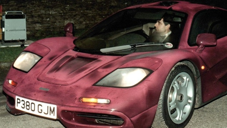 Photo dated Nov. 15 1998 of comedian Rowan Atkinson at the wheel of his McLaren F1 sports car. It was reported Friday Feb. 8 2013 that it took more than a year  and more than 900,000 pounds ($1,400,000)  to get his supercar up and running after a 2011 crash in which he badly injured a shoulder,  but F1's now sell for around 3.5 million pounds. The car makes extensive use of carbon fiber and needed specialist care. The car insurance settlement is one of the largest in British history. (AP Photo/Barry Batchelor/PA)  UNITED KINGDOM OUT  NO SALES  NO ARCHIVE