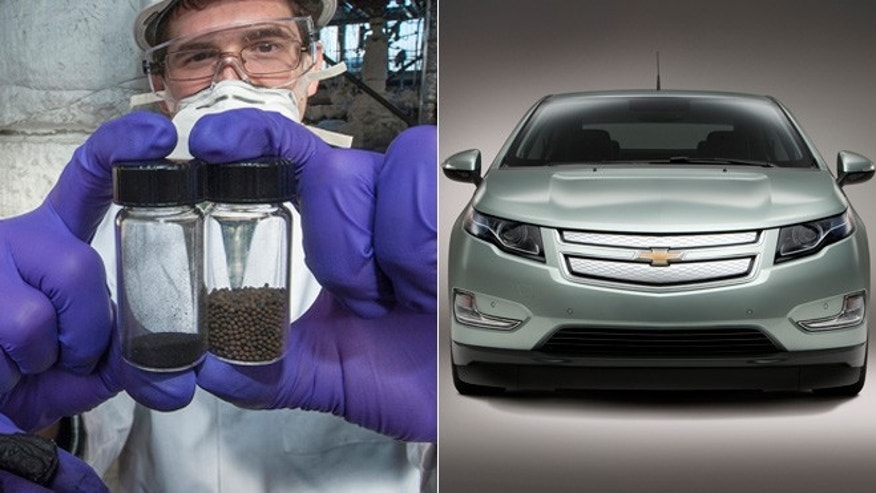 An OSU student holds up bottles of pulverized coal and iron oxide pellets/Chevrolet Volt