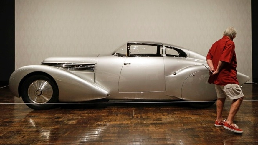 "Tandy Culpepper views a 1938 Hispano-Suiza H6 Dubonnet ""Xenia"" Coupe on Friday, June 14, 2013, in Nashville, Tenn., as part of the ""Sensuous Steel"" exhibit at the Frist Center for the Visual Arts. The exhibit is made up of cars and motorcycles from the 1930s and 1940s that exemplify the elegance and styling characteristic of the Art Deco style. The exhibit is scheduled to run through Sept. 15. (AP Photo/Mark Humphrey)"