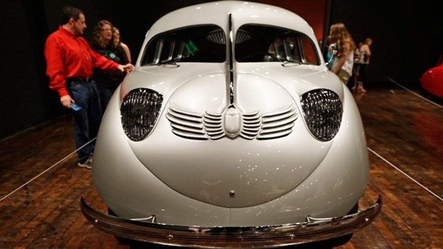 "People view a 1936 Stout Scarab on Friday, June 14, 2013, in Nashville, Tenn. as part of the ""Sensuous Steel"" exhibit at the Frist Center for the Visual Arts. The exhibit is made up of cars and motorcycles from the 1930s and 1940s that exemplify the elegance and styling characteristic of the Art Deco style. The exhibit is scheduled to run through Sept. 15.(AP Photo/Mark Humphrey)"