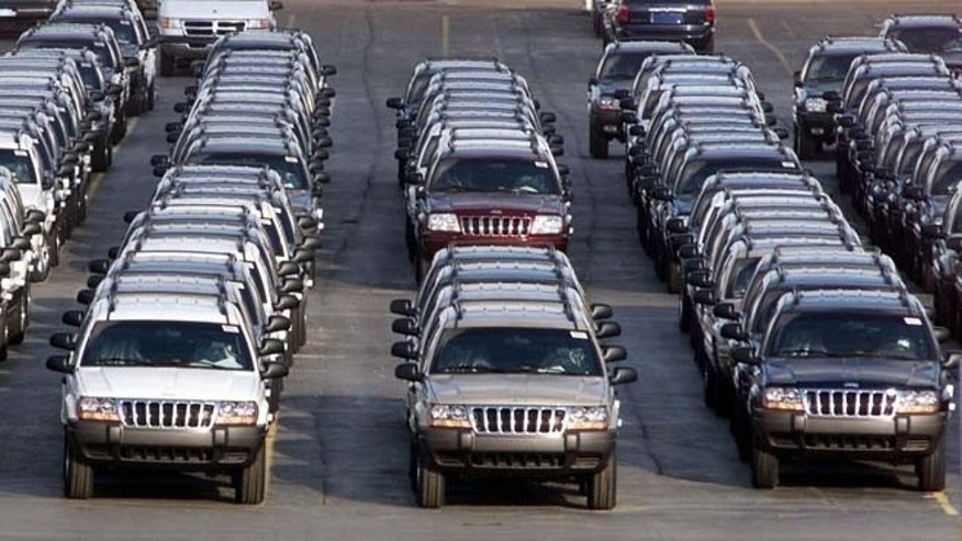 FILE - In this file photo taken Fed. 2, 2001, rows of 2001 Jeep Grand Cherokees are lined up outside the Jefferson North Assembly Plant in Detroit. Chrysler is refusing a request by U.S. safety regulators to recall about 2.7 million vehicles to fix fuel tanks that could leak and cause fires in rear-end collisions.The company says it's been asked by the government to recall Jeep Grand Cherokees from 1993 through 2004 and Jeep Libertys from 2002 through 2007. But Chrysler says in a statement that the SUVs are safe and not defective.  (AP Photo/Carlos Osorio, File)