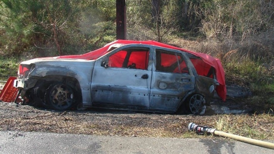 This March 6, 2012 photo provided by the law offices of Butler, Wooten & Fryhofer, LLP shows the scene of a crash in Bainbridge, Ga., where a 4-year-old boy named Remi Walden was burned and died when a Jeep Grand Cherokee was struck from the rear by a Dodge Dakota pickup truck. Chrysler is expected to file papers Tuesday, June 18, 2013, explaining why its refusing to recall 2.7 million older Jeep SUVs. (AP Photo/Courtesy of Butler, Wooten & Fryhofer, LLP)