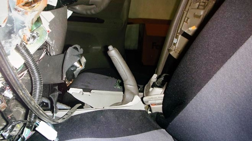 "FILE - In this undated file photo displayed during a news conference by the family of the Noriko Uno, who died in an alleged ""sudden unintended acceleration"" auto crash in August 2009, a photo of the interior of her Toyota 2006 Camry is shown with the hand brake handle pulled all the way back. Uno's case, in which her family claims her vehicle accelerated suddenly despite her efforts, is the first headed to trial where the Japanese automaker is accused of covering up defects that led to her death. (AP Photo/Uno Family, File)"