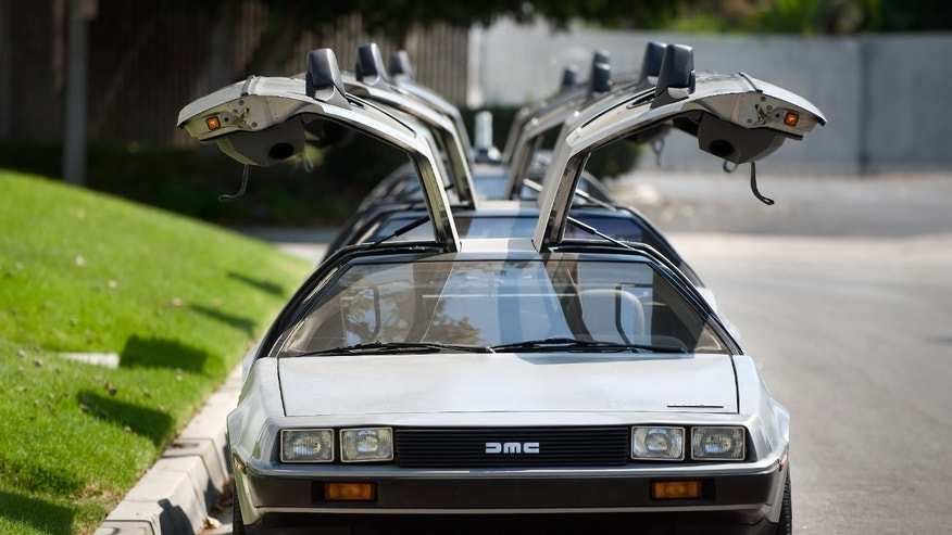 "This Sept. 10, 2013 photo shows DeLorean cars parked outside The DeLorean Motor Company in Huntington Beach, Calif. The cars were made from 1981-83 and were known for their stainless steel body and gull-wing doors. About 9,000 of the cars were made. People are having DeLoreans outfitted to resemble the car from the 1985 movie ""Back to the Future."" (AP Photo/Orange County Register, Paul Bersebach)"