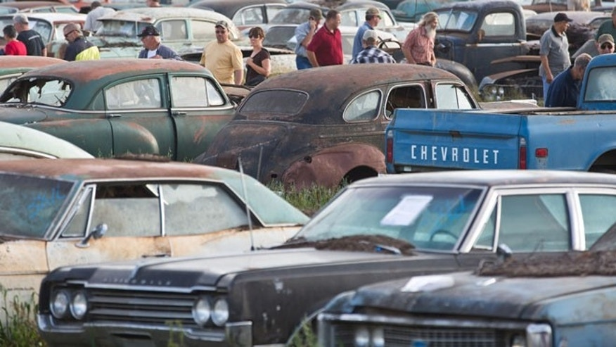 Potential bidders browse through some of about 500 vintage cars and trucks during a preview for an auction of  former Lambrecht Chevrolet dealership vehicles in Pierce, Neb.