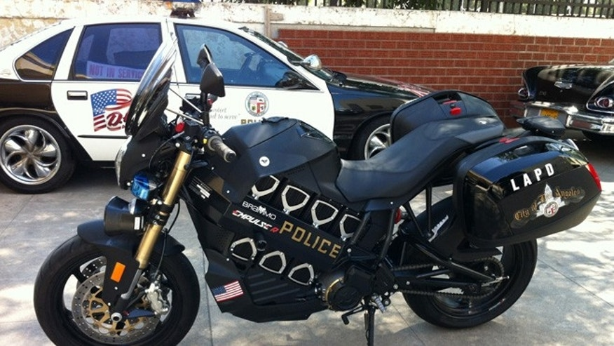 This undated image provided by Brammo shows an electric motorcycle outside police headquarters in Los Angeles. Such electric bikes are already used by a growing number of police departments across the country and around the world, including in Bogota, Colombia; Hong Kong, and closer to home, multiple agencies in California as well as New York, North Carolina and Oregon. It's a different, somewhat sleeker look than the burlier gas-powered BMWs and Harley Davidson's LA's police force uses today, but the department hopes the bikes will become a regular sight in its fleet of tomorrow.