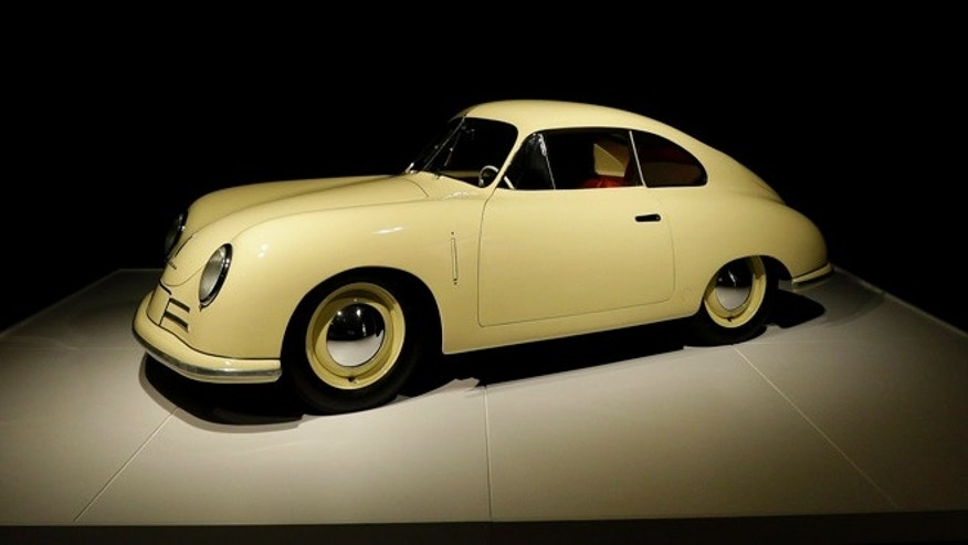 In this photo taken Wednesday, Oct. 9, 2013 a rare 1949 Porsche Type 356 Gmund Coupe is shown in the Porsche By Design Seducing Speed exhibit at the North Carolina Museum of Art in Raleigh, N.C. (AP Photo/Gerry Broome)
