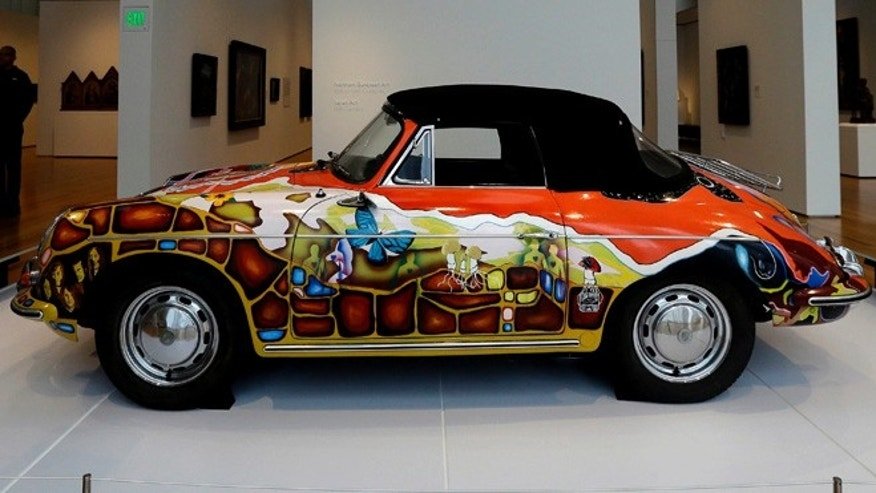 In this photo taken Wednesday, Oct. 9, 2013 a 1965 Porsche Type 356 C Cabriolet that once belonged to Janis Joplin is on display in the Porsche By Design Seducing Speed exhibit at the North Carolina Museum of Art in Raleigh, N.C. (AP Photo/Gerry Broome)