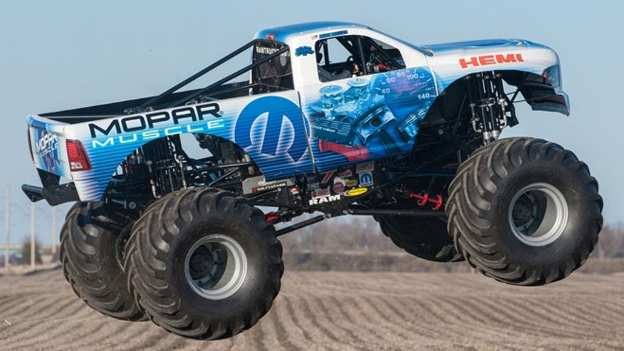"""Mopar Muscle"" joins championship winning Hall Brothers Racing trucks ""Raminator"" and ""Ramunition"" from for six Monster Jam events in 2014. The Mopar Muscle Monster Truck is a based on a 2014 RAM Heavy Duty truck, and is powered by a 565 cubic inch supercharged version of the famous 426 HEMI engine which celebrates the 50th anniversary of its introduction in 2014."