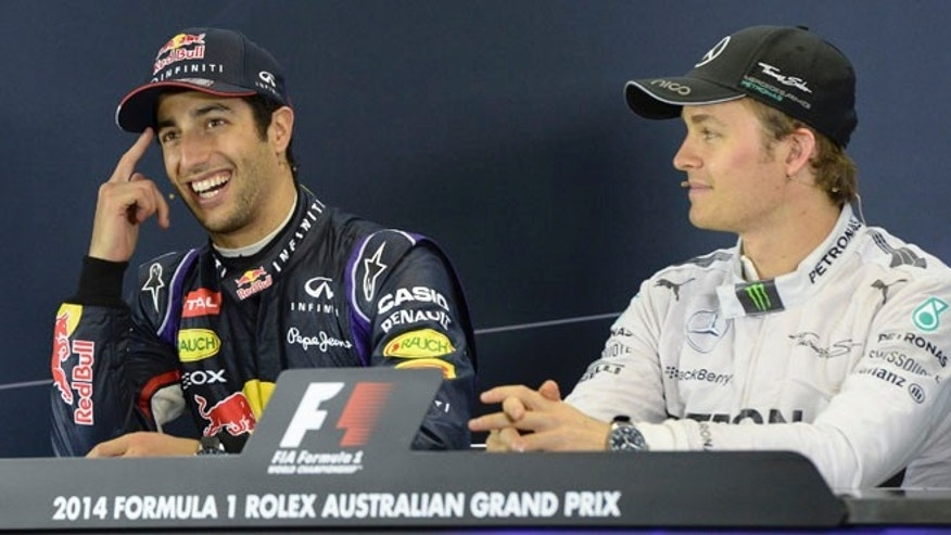 Red Bull driver Daniel Ricciardo of Australia,  left, and Mercedes driver Nico Rosberg of Germany, right, listen the questions during a press conference after the Australian Formula One Grand Prix at Albert Park in Melbourne, Australia, Sunday, March 16, 2014. Rosberg won the race and Ricciardo finished second. (AP Photo/Mal Fairclough)