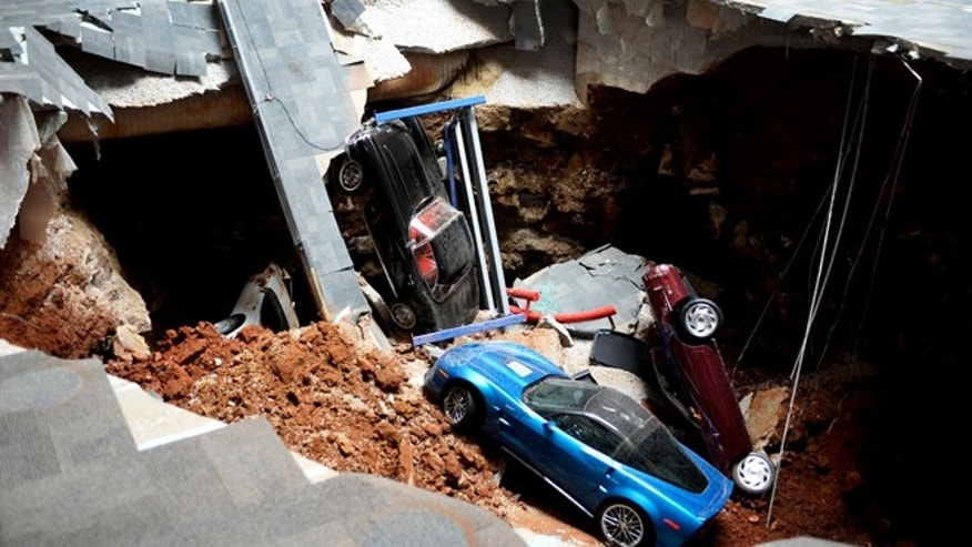 Feb. 12, 2014: Cars lie in a sinkhole that opened up at the Skydome showroom in the National Corvette Museum in Bowling Green, Ky.