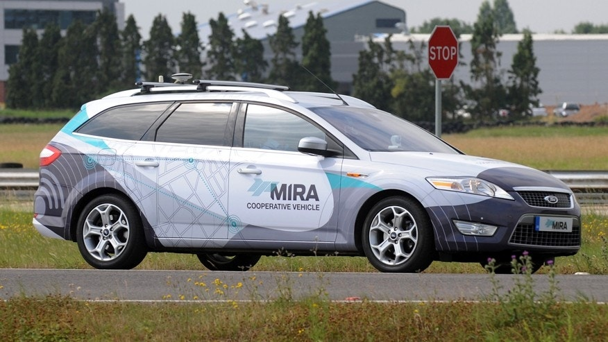 A driverless car during testing at the headquarters of motor industry research organization MIRA at Nuneaton in the West Midlands, England, Wednesday, July 30, 2014. British officials says driverless cars will be tested on roads in as many as three cities in a trial program to begin in January. Officials said Wednesday the tests will last up to three years. Sensors and cameras will guide the cars. (AP Photo/PA, Rui Vieira) UNITED KINGDOM OUT NO SALES NO ARCHIVE