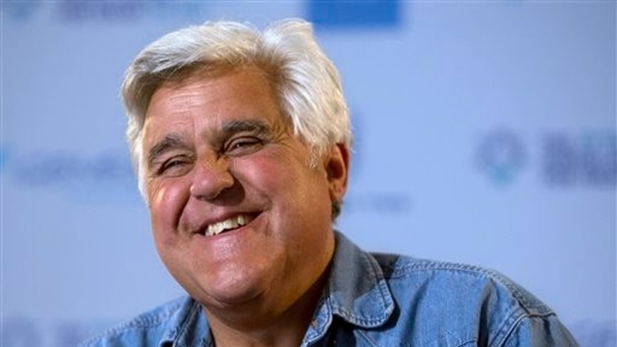 "FILE - This May 21, 2014 file photo shows American comedian Jay Leno smiles during an interview with the Associated Press in Jerusalem.  CNBC is returning Leno to nightly television. The new show, tentatively titled ""Jay Leno's Garage"" and based on his Emmy Award-winning web series, will premiere in 2015, the network announced Wednesday, Oct. 15, 2014. (AP Photo/Sebastian Scheiner, File)"