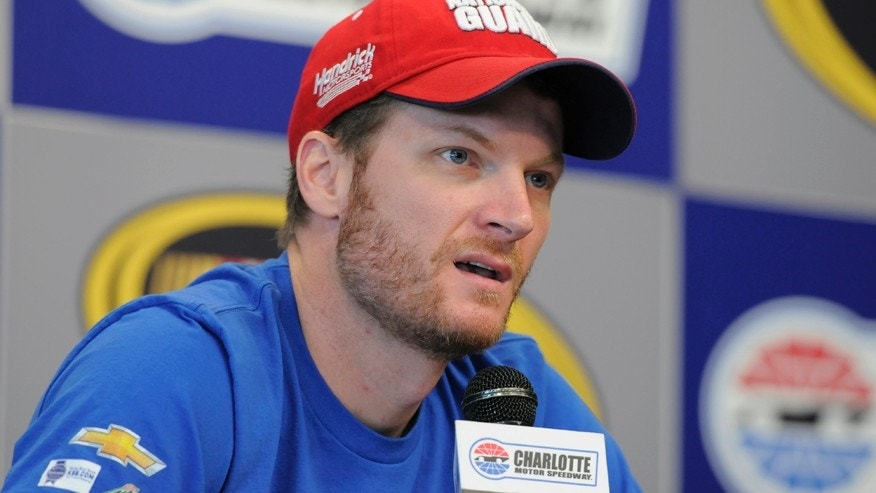 FILE - In this May 22, 2014, file photo, Dale Earnhardt Jr. speaks to the media before practice for the NASCAR Sprint Cup series Coca-Cola 600 auto race at Charlotte Motor Speedway in Concord, N.C. Earnhardt knew immediately something was wrong during a 2012 crash at Talladega, where his car was hit hard from behind. He recounts the crash in his personal story of his own battle with a concussion in a video made for the Sports Medicine Concussion Program at the University of Pittsburgh Medical Center. (AP Photo/Mike McCarn, File)