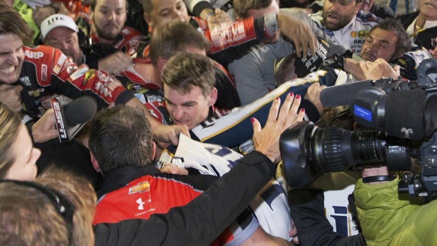Jeff Gordon is in the middle of a fight after the NASCAR Sprint Cup Series auto race at Texas Motor Speedway in Fort Worth, Texas, Sunday, Nov. 2, 2014.  The crews of  Gordon and Brad Keselowski fought after the race. (AP Photo/Matthew Bishop)