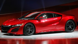 The Acura NSX debuts at media previews for the North American International Auto Show in Detroit Monday, Jan. 12, 2015. (AP Photo/Paul Sancya)