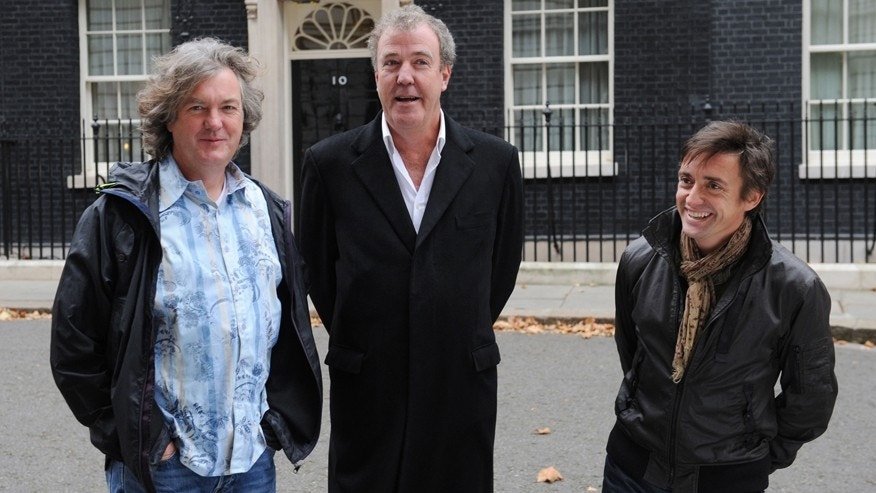 "FILE - A Nov. 29, 2011 photo from files showing television show Top Gear presenters James May, left, Jeremy Clarkson, centre,  and Richard Hammond standing outside No.10 Downing Street in London. The BBC said Tuesday it has suspended ""Top Gear"" host Jeremy Clarkson following a ""fracas"" with a producer. The popular TV presenter was suspended pending an investigation, the broadcaster said, without providing details. Clarkson, who has been in trouble before for behavior and remarks deemed offensive and provocative, was given a so-called final warning last year following a racism row. (AP Photo/PA, Stefan Rousseau)  UNITED KINGDOM OUT  NO SALES  NO ARCHIVE"
