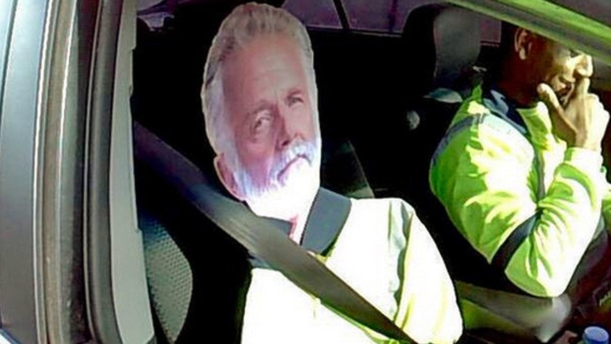 "This Monday, March 23, 2015 photo by Washington State Patrol Trooper Tony Brock shows a cardboard cutout of the ""The Most Interesting Man In The World,"" otherwise known as actor Jonathan Goldsmith, of Dos Equis beer TV commercial fame, strapped to the passenter seat of a driver who tried to use the image to qualify to drive the carpool lane on Interstate 5 near Fife, Wash. The trooper says it's by far the best carpool scam he's seen, but it didn't work. Both were chuckling as the driver, whose name wasn't released, said ""He's my best friend."" The Most Interesting Man was not confiscated, but the driver was told not to use him again. The State Patrol tweeted the photo, saying: ""I don't always violate the HOV lane law ... but when I do, I get a $124 ticket."" (AP Photo/Washington State Patrol, Trooper Tony Brock)"