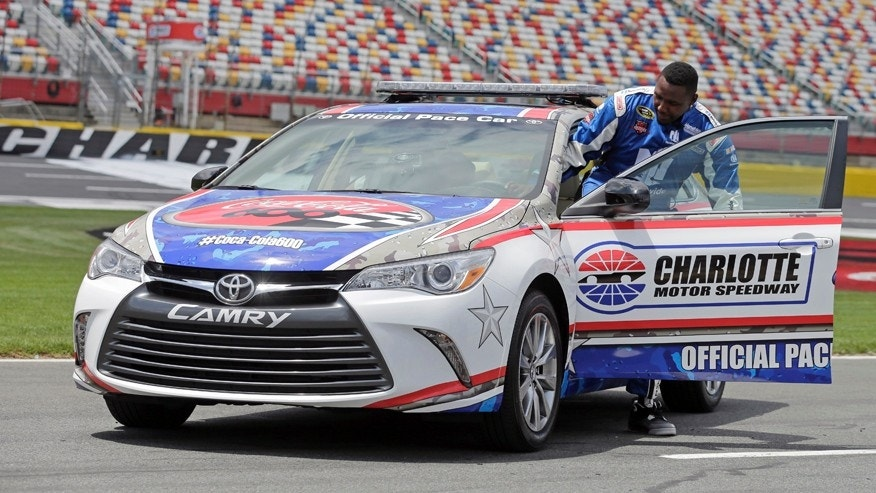 Carolina Panthers linebacker Thomas Davis climbs into the pace car at Charlotte Motor Speedway for his certification laps during a news conference in Concord, N.C., Tuesday, May 19, 2015. Davis, the NFL's Man of the Year, has been selected to be the honorary pace car driver for the Coca Cola 600 on Sunday. (AP Photo/Chuck Burton)