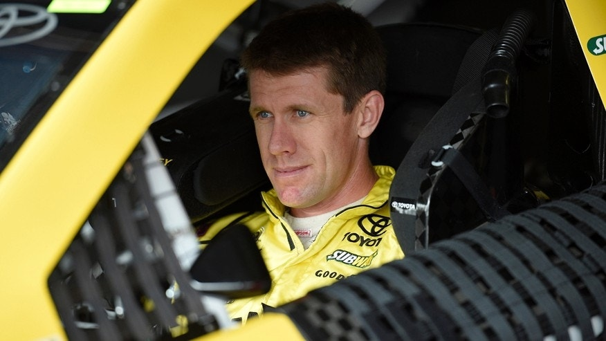 Carl Edwards looks out from his car before practice, Friday, May 29, 2015, for Sunday's NASCAR Sprint Cup series auto race at Dover International Speedway in Dover, Del. (AP Photo/Nick Wass)