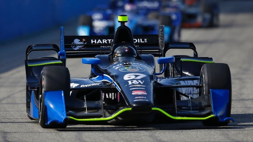 Josef Newgarden leads cars through a turn during the IndyCar Series race at the Milwaukee Mile in West Allis, Wis., Sunday, July 12, 2015. He won the pole position. (AP Photo/Jeffrey Phelps)