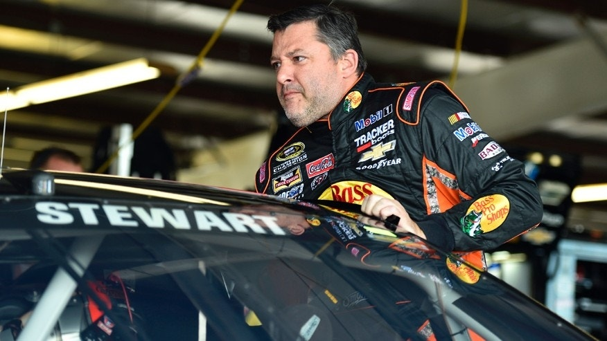 Tony Stewart climbs into his car before practice for Sunday's NASCAR Sprint Cup series auto race at Watkins Glen International, Friday, Aug. 7, 2015, in Watkins Glen, N.Y. (AP Photo/Derik Hamilton)