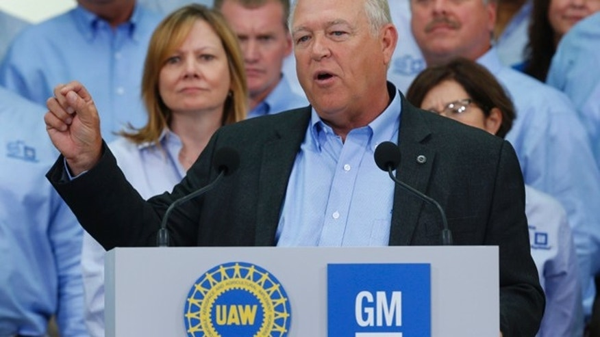 FILE - In this July 13, 2015, file photo, United Auto Workers President Dennis Williams speaks as General Motors CEO Mary Barra, background left, listens during a ceremony to mark the opening of contract negotiations in Detroit. (AP Photo/Paul Sancya, File)