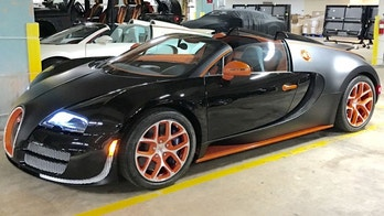 This Oct. 26, 2015 photo provided by Obi Okeke shows a 2015 Bugatti Veyron Grand Sport Vitesse sports car, purchased by boxer Floyd Mayweather Jr., in the parking garage of the Fontainebleau Hotel in Miami Beach, Fla. Mayweather purchased the $3.5 million sports car and posed for a photo with it on Instagram. (Obi Okeke via AP)