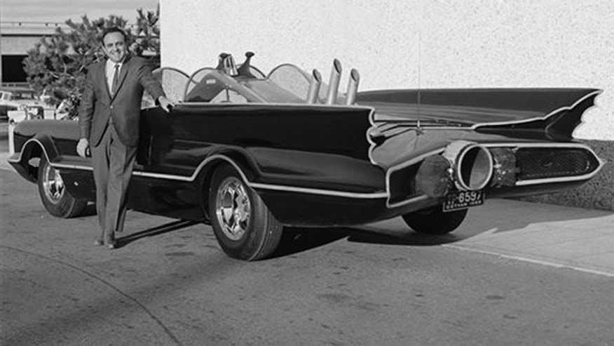 This 1966 photo provided by Lozzi Media Services and Barris Kustom Industries shows designer George Barris with the original Batmobile in Los Angeles.