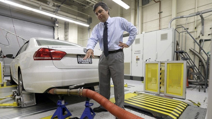 FILE - In this Sept. 30, 2015, file photo, John Swanton, spokesman with the California Air Resources Board, explains how a 2013 Volkswagen Passat with a diesel engine is evaluated at the emissions test lab in El Monte, Calif. California air quality regulators, on Tuesday, Jan. 12, 2016, rejected Volkswagen's recall plan to fix vehicles including the Beetle and Jetta that were programmed to trick government emissions tests. (AP Photo/Nick Ut,File)