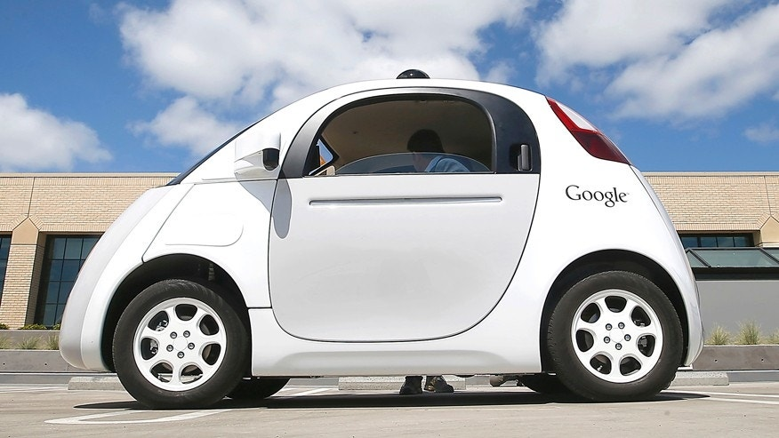 FILE - In this May 13, 2015, file photo, Google's new self-driving prototype car is presented during a demonstration at the Google campus in Mountain View, Calif.