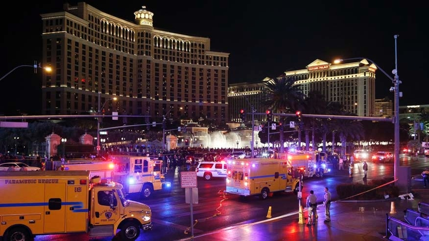 FILE - In this Dec. 20, 2015 file photo, police and emergency crews respond to the scene of a car accident along Las Vegas Boulevard in Las Vegas, after a woman drove her car into a crowd of tourists outside the Planet Hollywood and Paris casino-hotels. Pedestrian deaths surged by an estimated 10 percent last year as the economy improved, the price of gas plunged and motorists put more miles behind the wheel than ever before, according to an analysis of preliminary state traffic fatality data. (AP Photo/John Locher, File)