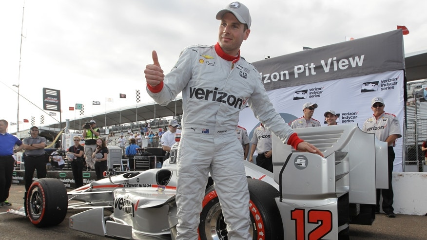 Will Power, of Australia, celebrates winning the pole position for Sundays IndyCar Firestone Grand Prix of St. Petersburg auto race, Saturday, March 12, 2016, in St. Petersburg, Fla.(AP Photo/Luis M. Alvarez)