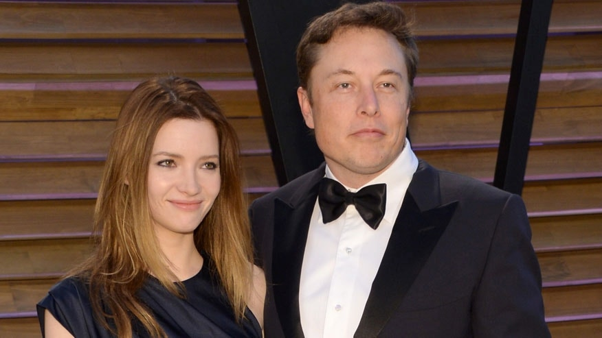 FILE - In this March 2, 2014 file photo, Talulah Riley, left, and Elon Musk attend the 2014 Vanity Fair Oscar Party, in West Hollywood, Calif. Riley has filed to end her second marriage to billionaire entrepreneur Elon Musk. Rileys filing Monday, March 21, 2016, in Los Angeles Superior Court is the second attempt to end the pairs second marriage. Musk filed for divorce on New Years Eve in 2014 but withdrew the petition seven months later. (Photo by Evan Agostini/Invision/AP, File)