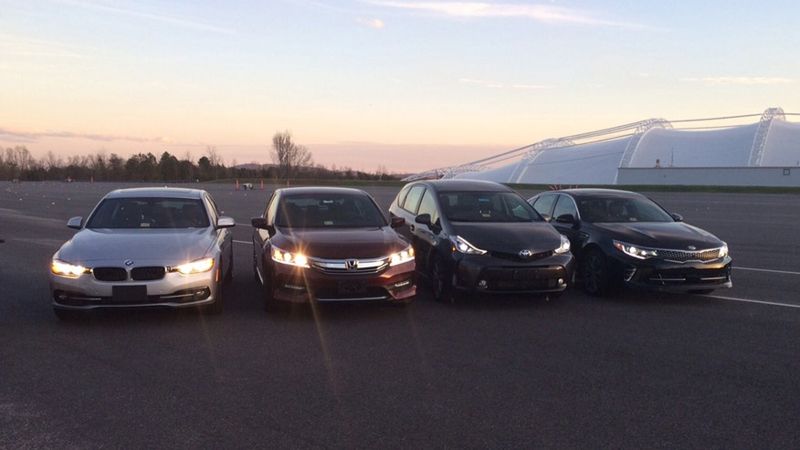 In this photo provided by the The Insurance Institute for Highway Safety, from left, a BMW 3 series, Honda Accord, Toyota Prius V and a Kia Optima are seen at the institutes Vehicle Research Center in Ruckersville, Va. A new study that rates the headlights of more than 30 midsized car models found only one model earned a good rating. Of the rest, half were rated acceptable and half were rated poor. The difference between the top-rated and bottom-rated model in terms of a drivers ability to see down a dark road was substantial. (Russ Rader/Insurance Institute for Highway Safety via AP)
