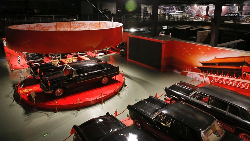 Red Flag car models are displayed with other vintage cars collected by Luo Wenyou at his private museum in Huairou district of Beijing.