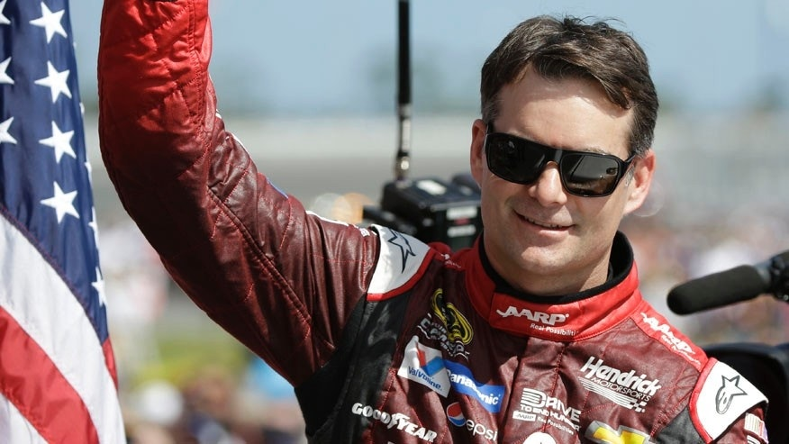 FILE - In this Feb. 22, 2015, file photo, Jeff Gordon gives a thumbs-up to the crowd as he in introduced before the Daytona 500 NASCAR Sprint Cup series auto race at Daytona International Speedway in Daytona Beach, Fla. Dale Earnhardt Jr. will miss two more races as he recovers from concussion-like symptoms and retired NASCAR champion Jeff Gordon will replace him at Indianapolis and Pocono. The announcement came Wednesday, July 20, 2016,  from Hendrick Motorsports, which said Earnhardt has not been cleared by doctors to drive. (AP Photo/John Raoux, File)