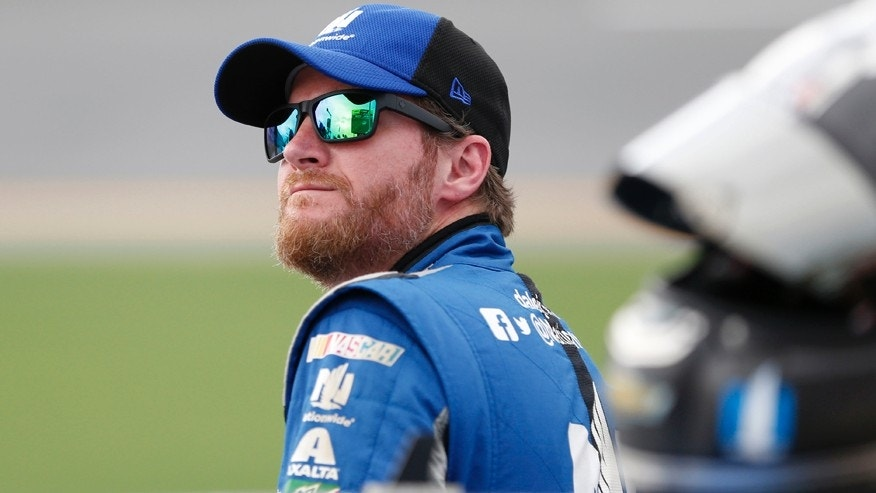 File-This July 1, 2016, file photo shows Dale Earnhardt Jr. watching the leader-board during qualifying for a NASCAR Sprint Cup auto race at Daytona International Speedway in Daytona Beach, Fla. (AP Photo/Wilfredo Lee, File)