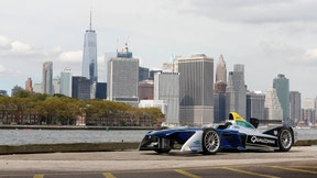 In this Sept. 20, 2016 photo provided by Formula E, a Formula E race car is shown in the Brooklyn borough of New York, with the Manhattan skyline in the background. Formula E, an all-electric racing series, will stage an event next year in Brooklyn. The New York City ePrix double-header will be the first FIA-sanctioned open-wheel race to take place in the five boroughs of New York City. (Formula E via AP)