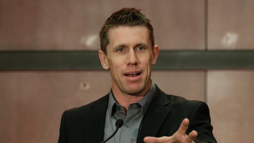 Carl Edwards speaks to the media during a news conference at Joe Gibbs Racing in Huntersville, N.C., Wednesday, Jan. 11, 2017. Edwards announced he was stepping away from racing. (AP Photo/Chuck Burton)