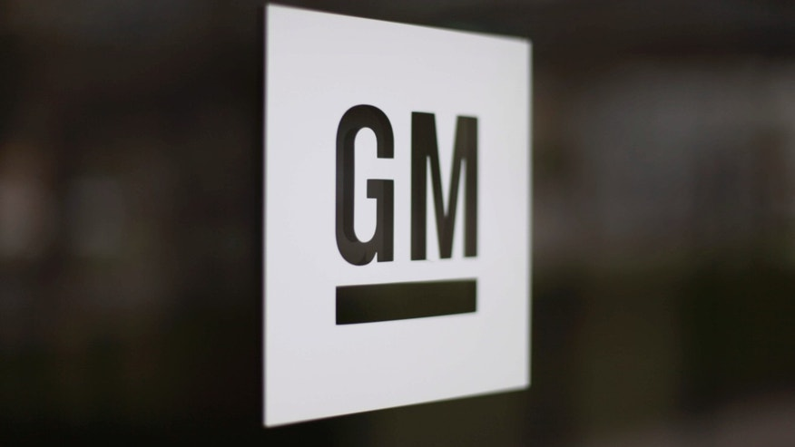 FILE - This Friday, May 16, 2014, file photo, shows the General Motors logo at the company's world headquarters in Detroit.