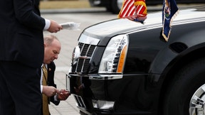 Secret Service agents change license plates on the presidential limousine at the U.S. Capitol as Donald Trump takes the other of office and becomes the 45th president of the United States, Friday, Jan. 20, 2017, in Washington. (AP Photo/Alex Brandon)