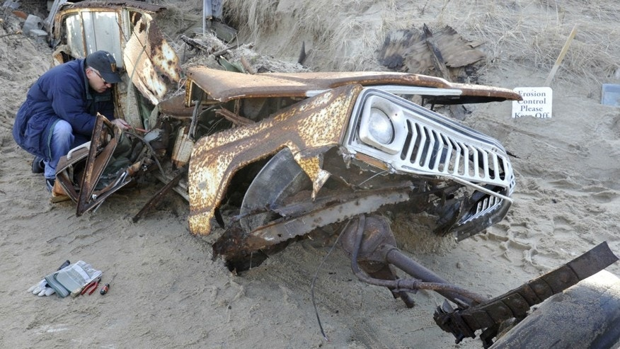 Jeep buried in sand dune for 40 years is finally unearthed