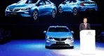 SAIC-GM president Wang Yongping announces the global launch of the Buick Velite 5, an extended range electric hybrid, during a global launch event ahead of the Shanghai Auto 2017 show in Shanghai, China, Tuesday, April 18, 2017. At the auto show, the global industry's biggest marketing event of the year, almost every global and Chinese auto brand is showing at least one electric concept vehicle, if not a market-ready model. (AP Photo/Ng Han Guan)