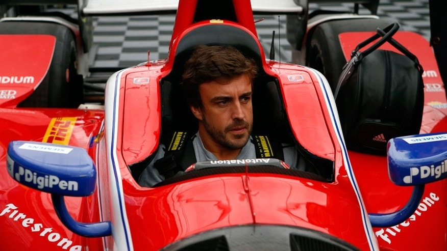 Fernando Alonso being fitted for an IndyCar at Barber Motorsports Park in Alabama on April 23.