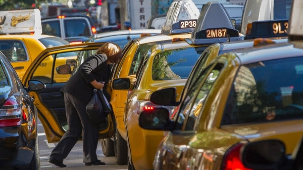 A woman exits a taxi on Third Avenue in heavy traffic caused by road closures due to high security and official motorcades during the United Nations General Assembly, in New York, September 24, 2013. REUTERS/Zoran Milich (UNITED STATES - Tags: POLITICS) - RTX13XSU