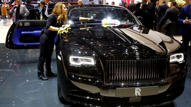 A Rolls-Royce Wraith Black Badge car is seen during the 87th International Motor Show at Palexpo in Geneva, Switzerland March 8, 2017. REUTERS/Arnd Wiegmann - RTS11YVW