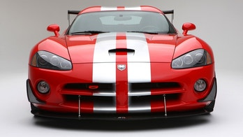 Newbury Park, California USA - January 23,2011: Dodge Viper SRT10 red with silver stripes photographed in the studio. Generation III of the dodge Viper.